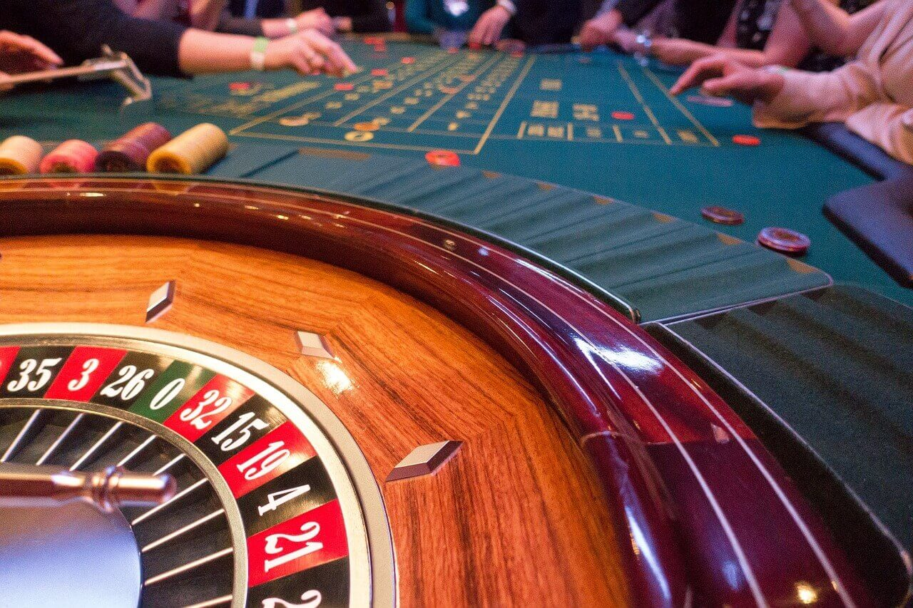 Roulette table games in a casino with players and chips